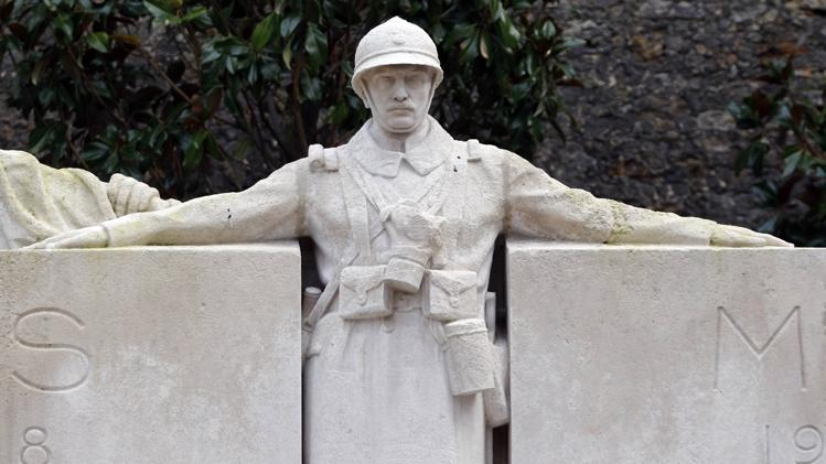 Statue of a Poilu (French infantryman during World War I) at war memorial in XVth district/REUTERS-Charles Platiau